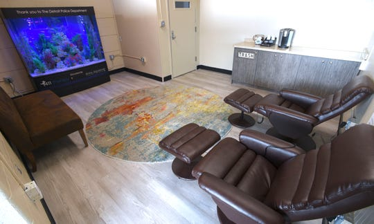 The police officers' meditation room promotes decompression with a 500-gallon, salt-water fish tank and two massage chairs at DPD's NW Precinct.