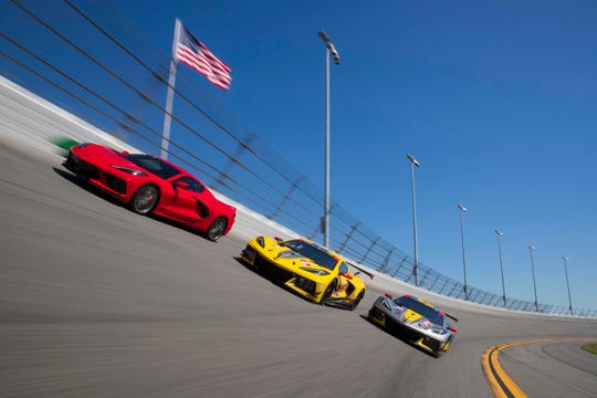 The production Corvette C8 (red, left) with the C8.R race car on the banking at Daytona International Speedway in Daytona Beach, Florida.