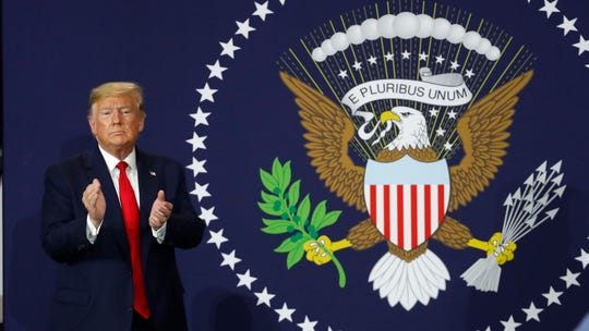 President Donald Trump claps after speaking at Dana Incorporated, Thursday, Jan. 30, 2020, in Warren, about the new North American trade agreement.