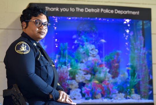 Detroit Police Department (DPD) Captain LaShanna Potts poses in front of a 500-gallon, salt-water fish tank in the police officers' meditation room at the 6th precinct, Thursday afternoon, Jan. 30, 2020. Potts went through emotional issues, including suicidal thoughts, after she watched her partner, Richard Scalf, get killed in 1999.