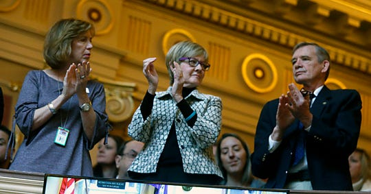 Gun safety advocates, from left, Lori Haas, Barbara Parker and Andrew Goddard, applaude a house speech by Del. Patrick Hope, D-Arlington, who spoke in favor of a number of gun-related bills during the floor session of the Virginia House of Delegates inside the State Capitol in Richmond, Va., Thursday, Jan. 30, 2020.
