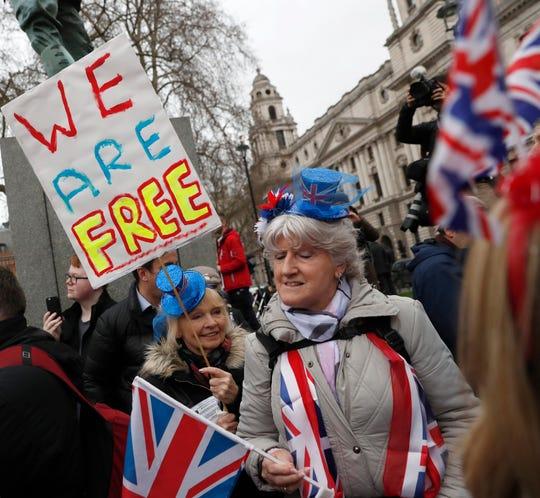 Brexiteers celebrate in London, Friday.