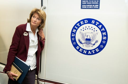 Sen. Lisa Murkowski, R-Alaska., takes the Senate subway as she leaves the Capitol in Washington, Tuesday, Jan. 28, 2020.