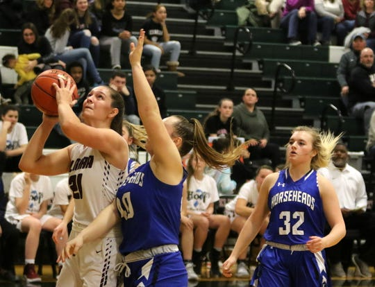 Elmira's Morgan Gentile goes up for a shot as Horseheads' Tess Cites (40) and Maddie Johnson (32) defend during the Express'  66-45 win in girls basketball Jan. 30, 2020 at Elmira High School.