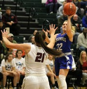 Maddie Johnson of Horseheads takes a shot in front of Elmira's Morgan Gentile during the Express' 66-45 win in girls basketball Jan. 30, 2020 at Elmira High School.