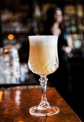 A whiskey sour flip, made by the bartenders at The 86 Room, is frothed with egg whites.