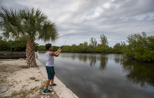 Corey Lorenzo, 10, of Fort Myers, fishes along the parking area at D & D Matlacha Bait and Tackle Friday afternoon, January 31, 2020. The iconic and family-owned shop on Pine Island Road has been in business for 30 years. The city of Cape Coral  bought the property and may now sell the land.