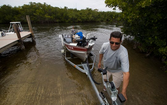 Dominic Luciano, of Lehigh Acres, uses one of the the boat ramps Friday afternoon, January 31, 2020, at D & D Matlacha Bait and Tackle. The iconic and family-owned shop on Pine Island Road has been in business for 30 years. The city of Cape Coral  bought the property and may now sell the land.