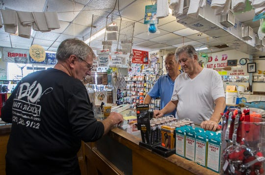 Bob Mansfield tends to customers Friday afternoon, January 31, 2020. The iconic and family-owned bait and tackle shop, D&D on Pine Island Road has been in business for 30 years. The city of Cape Coral  bought the property and may now sell the land.