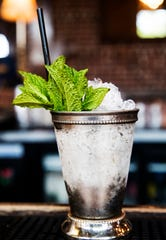 A mint julep in a classic silver cup, made by the bartenders at The 86 Room in downtown Fort Myers.