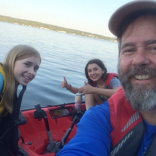 Mike McCarthy with daughters Molly and Megan aboard his Hobie Mirage Outback kayak during one of the legs of his journey to circumnavigate the waters of Door County.