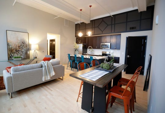 Pictured is the kitchen and living area of an apartment at Whitney School Lofts. A grand opening for the property, located at 215 N. Webster Ave., was held Jan. 30, 2020 in Green Bay, Wis.