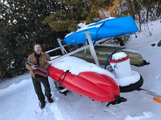 Mike McCarthy shows off the Hobie Outback kayaks and Mirage Drive pedaling mechanism that he used to circumnavigate the waters of Door County, a journey of more than 185 miles, outside Village Green Lodge in Ephraim.