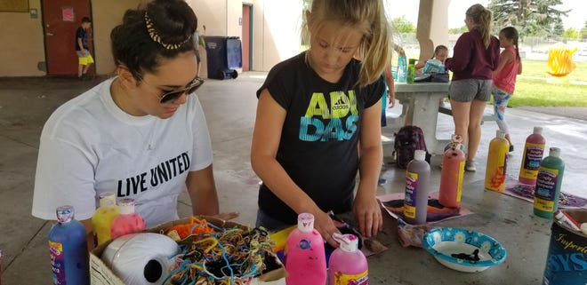 Marion Talcott helps kids with crafts as part of a recent United Way funded Park Pals program. United Way of Cascade County announced recently it raised upwards of $1.1 million last year toward community impact work and nonprofit programs.