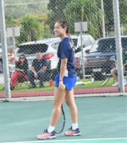 Harvest Christian Academy's No. 1 singles seed Paige Mantanona smiles before a serve playing in this file photo. The Eagles finished undefeated at 9-0 to win the girls title.