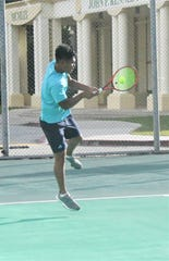 John F. Kennedy's Mark Fontanilla hits a backhand against Harvest Christian Academy's Joshua Choi in their high school tennis match Jan. 30 at JFK. Fontanilla won his No. 1 singles match 8-0, leading JFK to a 32-8 win over the Harvest boys.