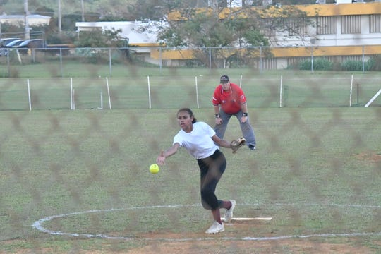 Okkodo High School pitcher Kaela Enriquez lets one fly in the second inning against JFK in a Guam DOE ISA softball match Jan. 30 at JFK.