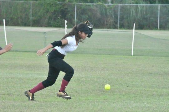 Okkodo second baseman Kianna Clark chases down a ball hit by JFK in a Guam DOE ISA softball match Jan. 30 at JFK.