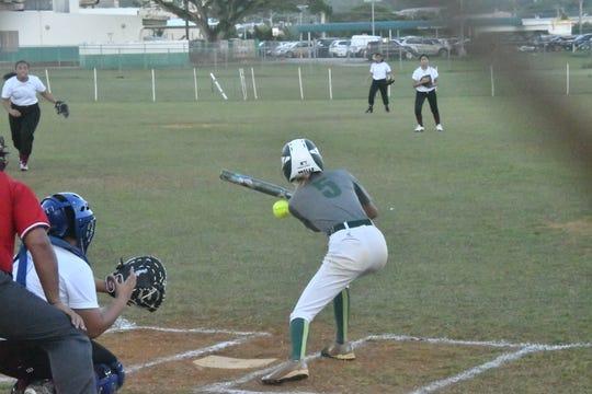 JFK batter Franchesca Manosa just misses on a bunt against Okkodo in a Guam DOE ISA softball match Jan. 30 at JFK.