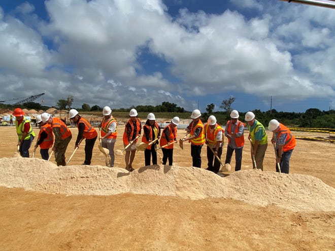 Speaker Tina Rose Muna Barnes, seventh from the left, and Sen. Telo Taitague, sixth from the left, joined the Limtiaco family, Defense Logistics Agency Troop Support leadership, military officials, Barrigada vice mayor Jessie Bautista, fourth from the left, and Black Construction to break ground at Pacific Unlimited's new cold storage distribution facility Thursday.