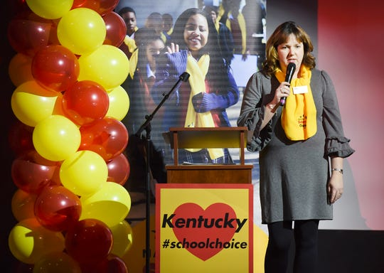 Julie Eadens, president of Holy Name School in Henderson, speaks on stage at the National School Choice Week rally on Friday at the Bluegrass Music Hall of Fame & Museum.