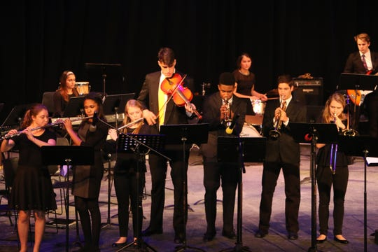 Luka Garza stands out at a Maret School concert, as the world's tallest viola player. Teachers there recalled him as a passionate and dedicated musician who just enjoyed being part of the ensemble.