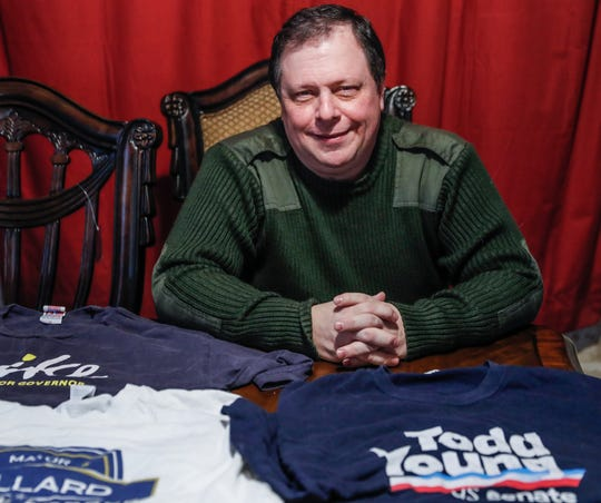 Ed Adams, a precinct committeeman for precinct 18-02 in Marion County, shown here at his Indianapolis home with some of his political T-shirts, has submitted a letter of resignation to the Marion County GOP, Friday, Jan. 31, 2020. Adams has been watching the impeachment trial with disdain and says nothing is left of the Republican party he once served.