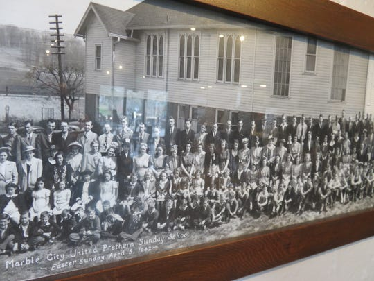 Photo of old Marble City United Brethren church from 1942 is shown on the wall of the Golden Roast coffee house on Jan. 27, 2020