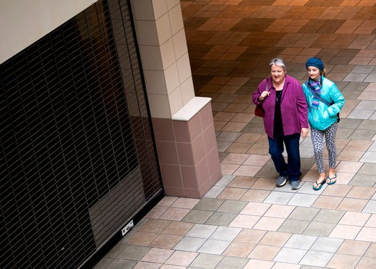 Jan Cleveland and Lily Dovenbarger explore Knoxville Center Mall, formerly known as East Towne Mall, on its final day on Friday, January 31, 2020.