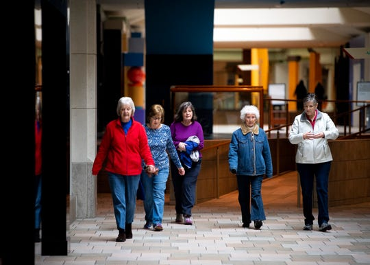 Mall walkers, from second to left, Gail Bowers, Ann Papa, Janiece Binger and Debbie Horner walk laps around Knoxville Center Mall, formerly known as East Towne Mall, on its final day on Friday, January 31, 2020.