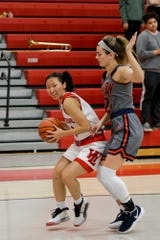 West Lafayette's Christina Shi (3) is guarded by Harrison's Tasi Kukobat (32) during the second quarter of an IHSAA girls basketball game, Thursday, Jan. 30, 2020 in West Lafayette.