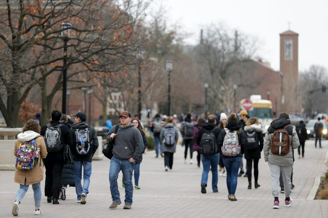 Pedestrians walk across Purdue University, Thursday, Jan. 30, 2020, in West Lafayette.