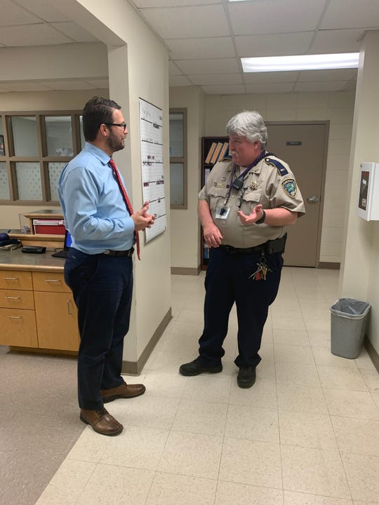 West Feliciana Parish Schools Superintendent Hollis Milton discusses safety concerns with School Resource Officer Scott Lathrop at Bains Elementary School.