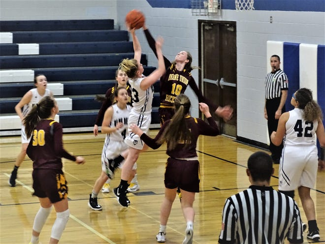 Berne Union freshman Sophia Kline blocks a Danville shot during the Rockets' 57-33 non-conference win Thursday night.