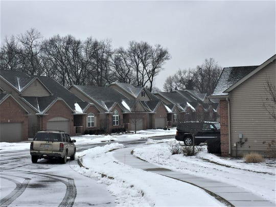 Residents on Spring Mountain Drive in Brighton, shown Thursday, Jan. 30, 2020, live south of a a 70-home development that is proposed on the land. Neighbors are concerned the new homes will add to existing problems with erosion and flooding.