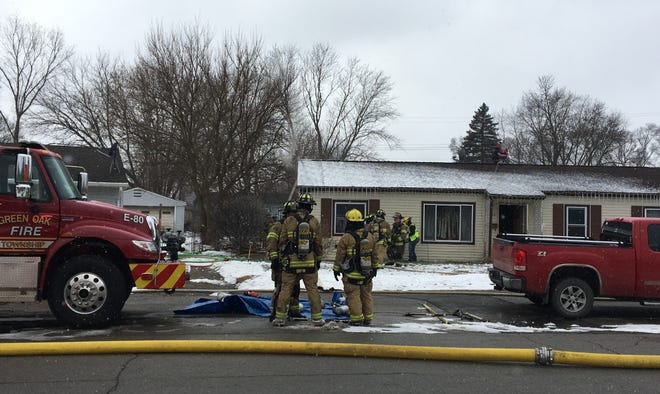 Firefighters respond to a house fire at the 6200 block of Marcy Drive in Green Oak Township, Friday, Jan. 31, 2020. Smoke was visible.
