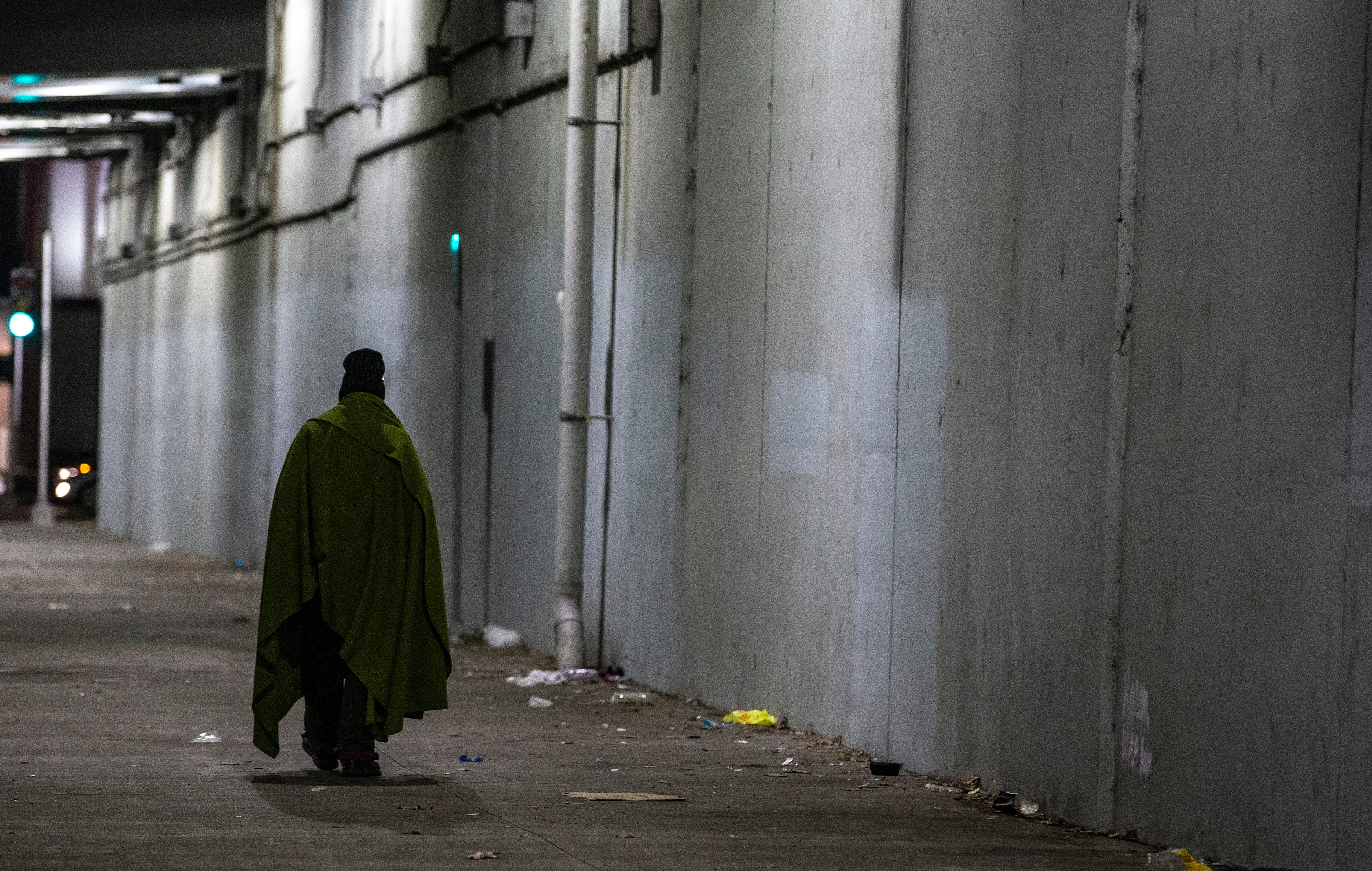 5:57 AM  A homeless man walked along Jefferson Street under the I-65 overpass, with a blanket around him on Jan. 30, 2020. Volunteers canvassed the area for the 2020 Street Count census of the homeless.