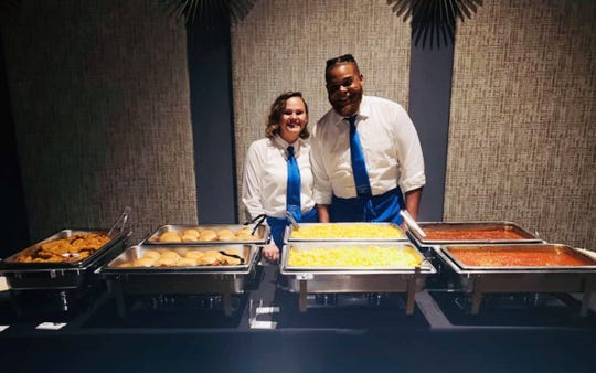 Dayna Clark and Terrance Buchanan of Cadillac's Chicken and Fish.