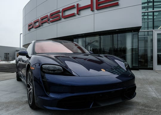 Serra Auto Campus in Okemos showcases a new Porshe Taycan electric vehicle at the new dealership location on Jolly Road Friday, Jan. 31, 2020.