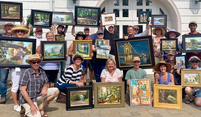 Members of the Ohio Plein Air Society show off their work. The group will have an exhibition at the Mansfield Art Center this summer.