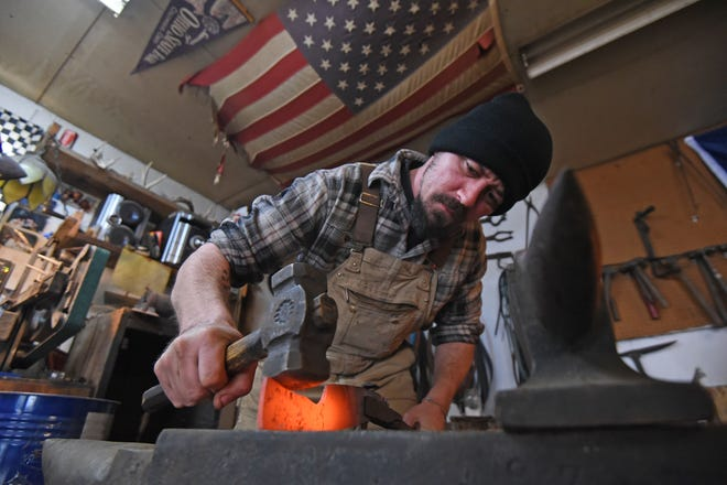 "Dustin Parrella hammers hot metal in his garage Friday afternoon. Parrella will be on ""Forged in Fire"" Wednesday on the History Channel."