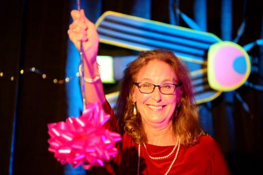 Betty Preston twirls a baton after winning the 2019 Chairman's Award during Richland Area Chamber and Economic Development's annual meeting.