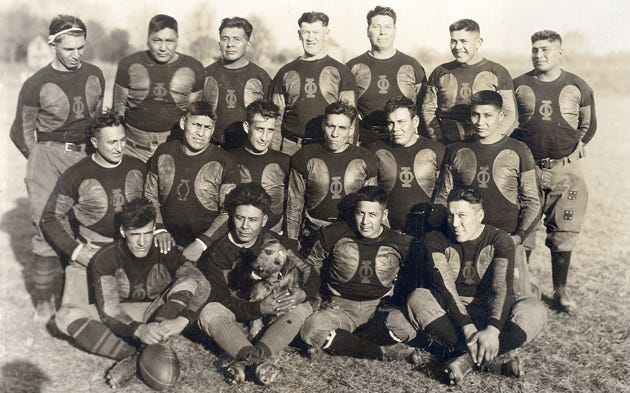 Oorang Indians with Jim Thorpe in Middle of Back Row.