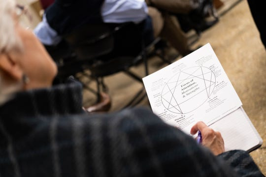A participant in an Enneagram workshop led by Sandra Smith reviews her notes, Thursday, Jan. 30, 2020, in Memphis.
