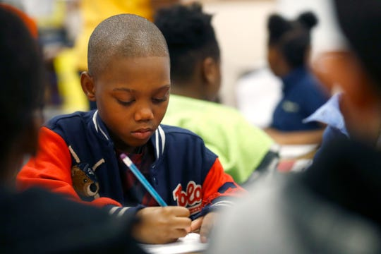 Antonio Turner, 8, works on his assignment in Corey Dixon's third grade reading, English, and language arts class at Hickory Ridge Elementary School on Friday, Jan. 31, 2020.
