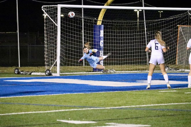 Junior goalkeeper Kirra Polley makes a sprawling save to preserve Marco Island Academy's 1-0 win over Barron Collier on Tuesday.