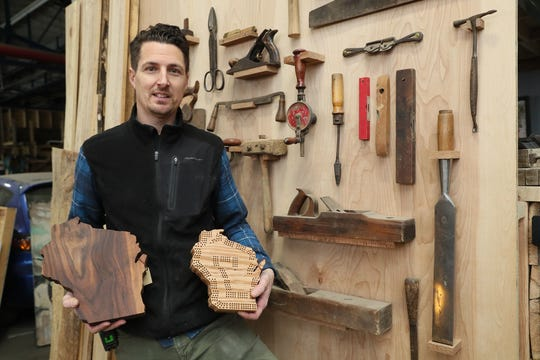 Nick Hardrath of The Urban Craftsman shows his hardwood silhouettes of Wisconsin, which he cut and finished.  The one on the right is a cribbage board.
