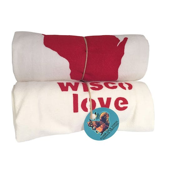 Flour sack towels made by Leslie Phillips show Wisconsin pride.