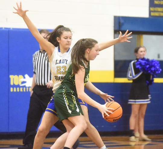 Mountain Home's Lauren Wehmeyer defends a Greene County Tech player during a recent contest. The Junior Lady Bombers defeated Jonesboro Annie Camp on Thursday night.