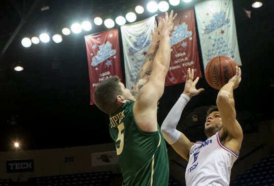 Louisiana Tech's Kalob Ledoux (5) looks to make a shot while Charlotte's Milos Supica (5) attempts to block during the conference game at the Thomas Assembly Center in Ruston, La. on Jan. 30.